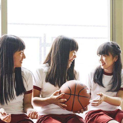 Japanese junior high school girls talking in a corner of the gym